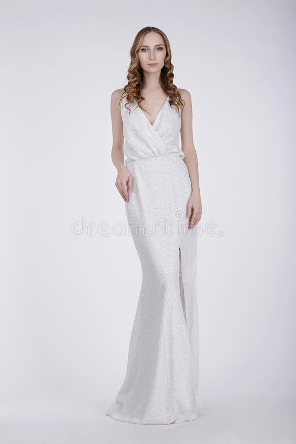 Full Length of Young Woman in White Evening Dress royalty free stock images