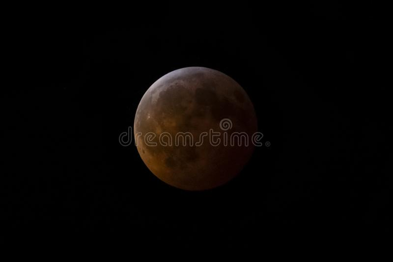 Super Blood Wolf Moon Lunar Eclipse. A full lunar eclipse turns the moon a warm red color. Photographed on January 21, 2019 stock photos
