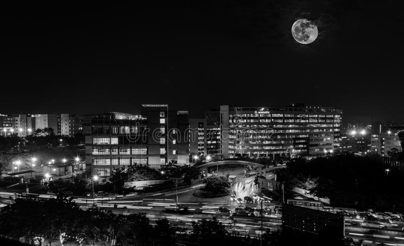 Full moon above city stock photography