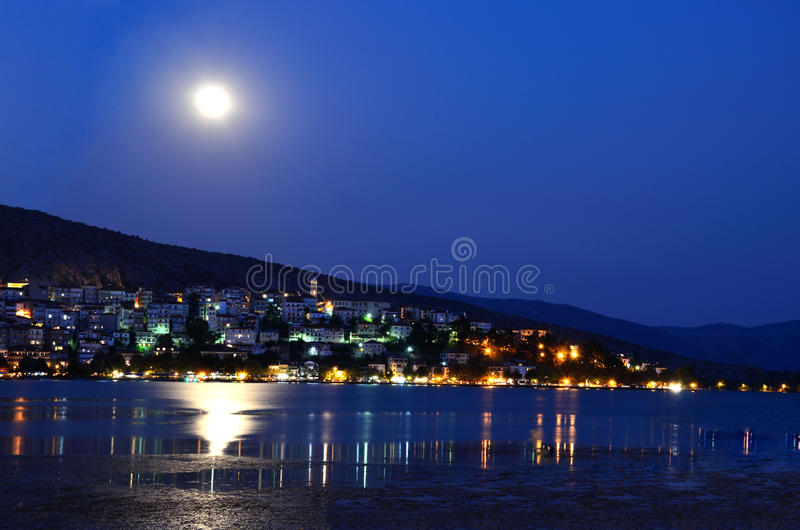 Full moon above the city with lake. Full moon above Kastoria city, Greece stock image