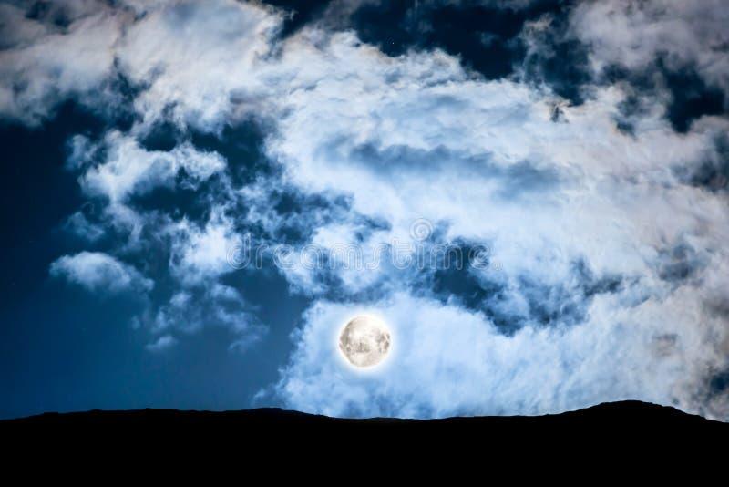 Full moon above mountain stock photo