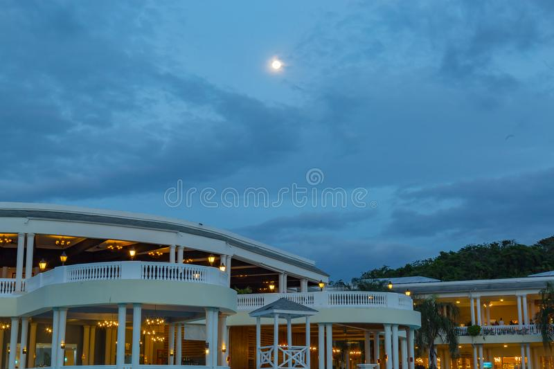 Full moon as seen over the blue lagoon at Grand Palladium at night. Full moon on blue sky as seen over the blue lagoon Grand Palladium Montego Bay Lucea Jamaica royalty free stock image