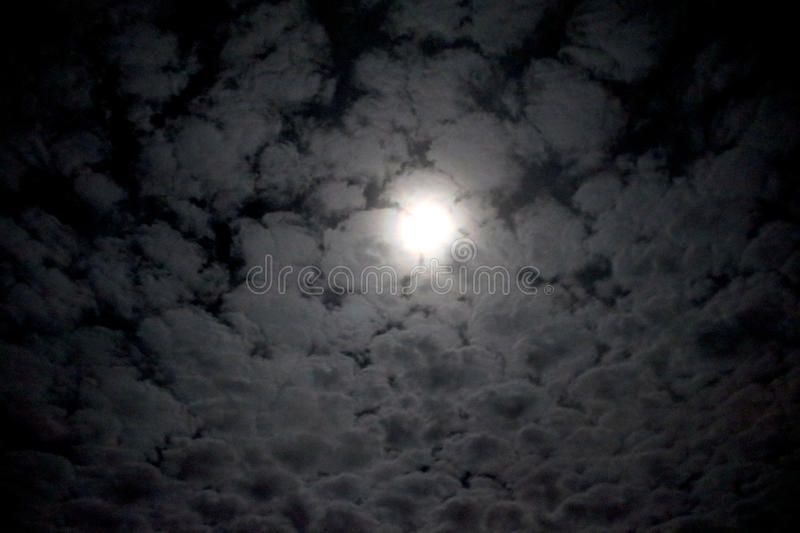Full moon behind the clouds stock images