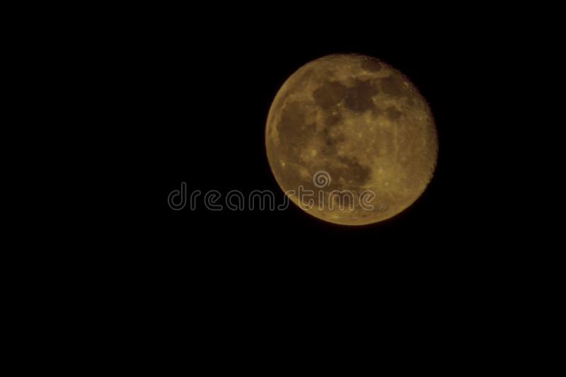Full moon on black background.Look again is awesome suitable for Halloween background. Moon orbit planet Earth. stock images