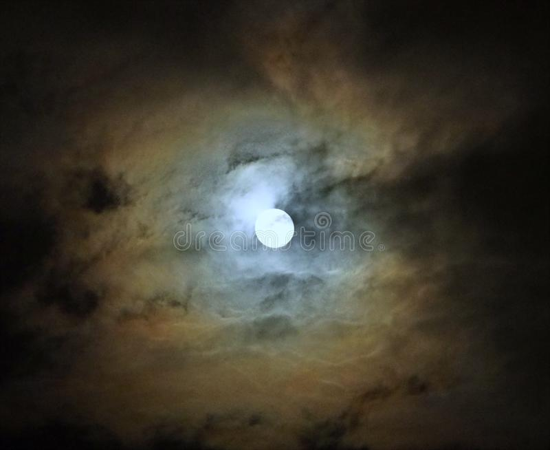 Moon after lunar eclipse and blue clouds royalty free stock images