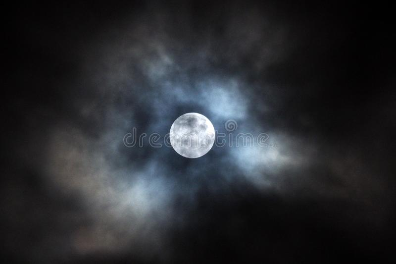 Moon after lunar eclipse and blue clouds royalty free stock photos