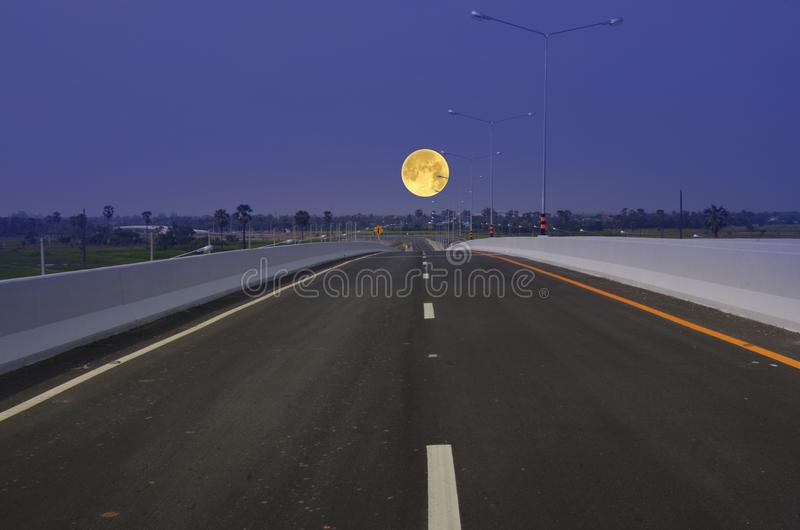 Full moon in blue sky and lonely road royalty free stock images