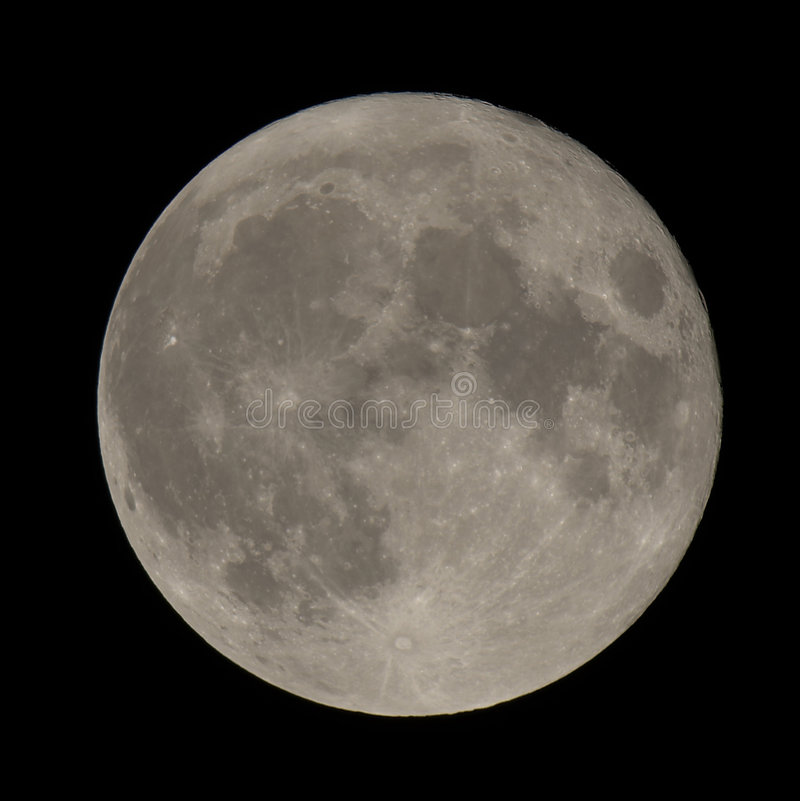 Full moon closeup showing craters stock photography