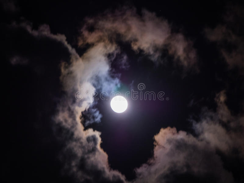 Full Moon and Cloud stock images