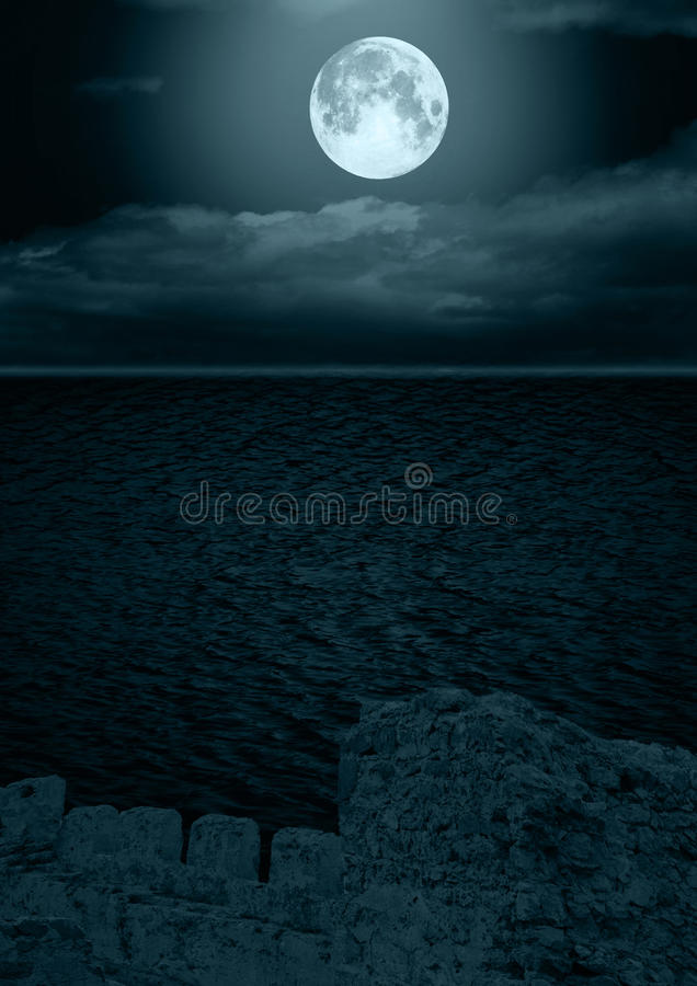 Full moon in clouds royalty free stock photography