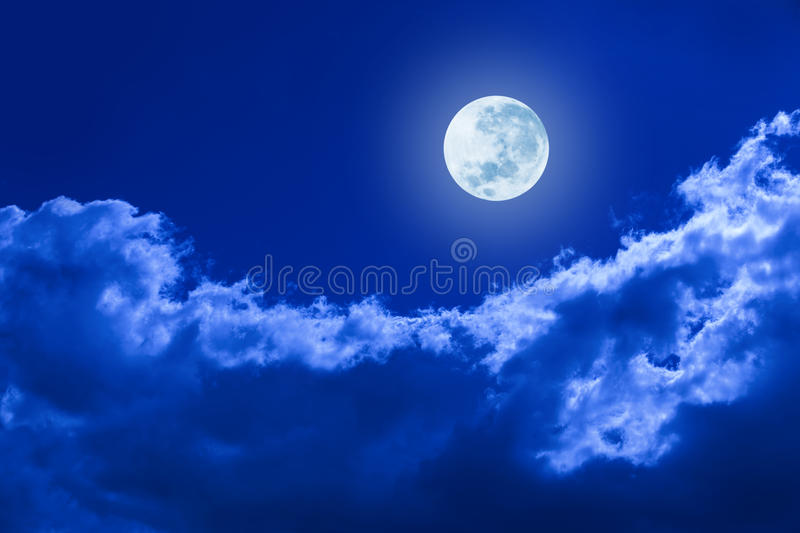 Full Moon Clouds Night Sky. A full moon glowing in a night sky with clouds