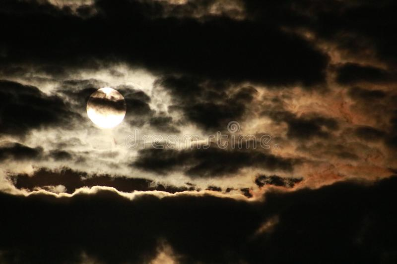 Full moon on a cloudy night stock photography