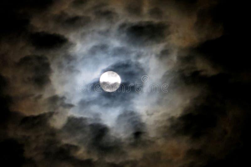 full moon in cloudy sky 3 stock photo