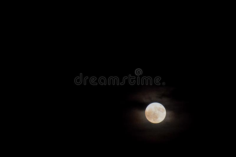 Full moon in a cloudy sky with halo. Photo Picture Full moon in a cloudy sky with halo royalty free stock photo