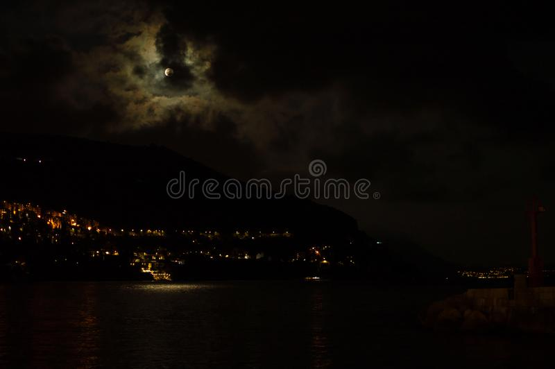 Full Moon in Cloudy Sky over Dubrovnik Harbor, Croatia. Full Moon in Cloudy Sky over Dubrovnik Harbor in Croatia stock photography