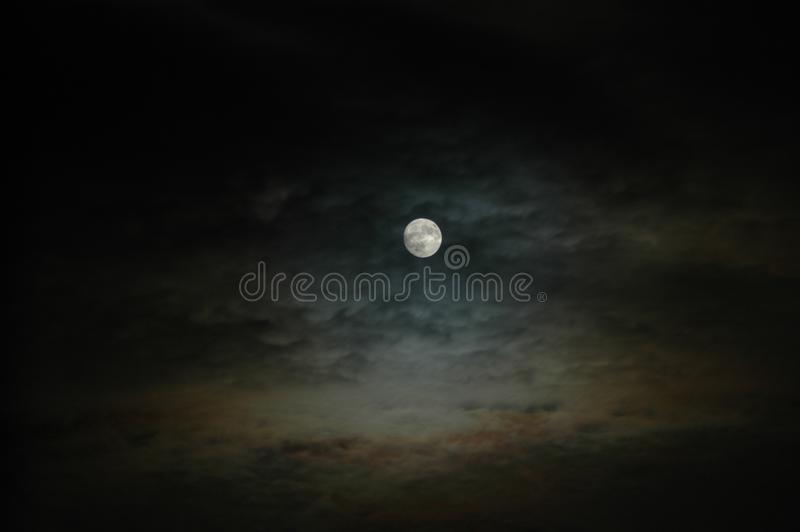 Full moon with cloudy sky in sandbach, cheshire, england. United kingdom royalty free stock image