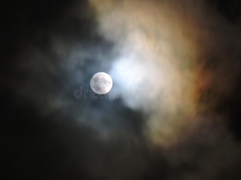 Full moon. And colorful clouds in natural black sky background stock images
