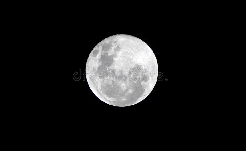 Full moon on the dark night stock photo