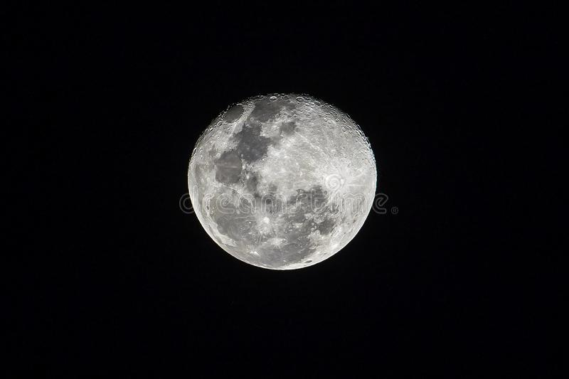 Full moon on the dark night shining on the sky in cloudy day stock images