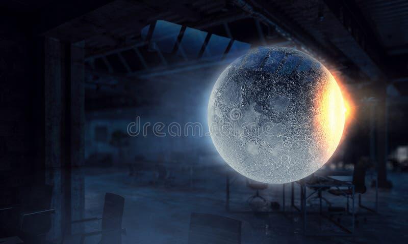 Moon planet in office. Mixed media. Full moon in dark office interior. Mixed media royalty free stock photo