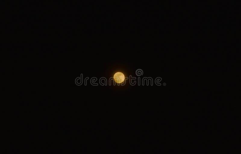 Full moon on dark sky in night stock photos