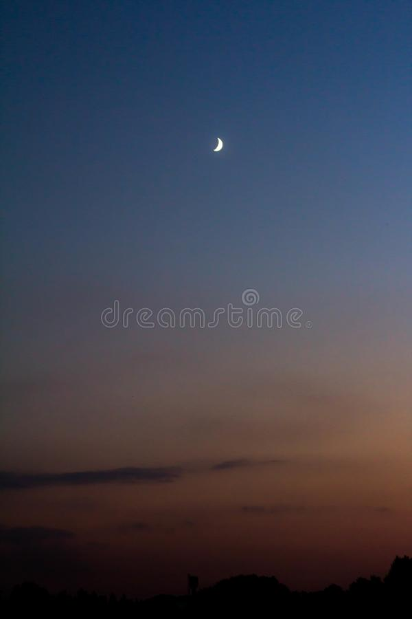 The Full Moon in daylight blue sky royalty free stock photo