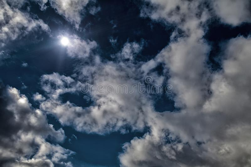 Full moon dramatic sky moonlight midnight blue sky white clouds bright sun background. HDR style processing. up aerial view. stock photography