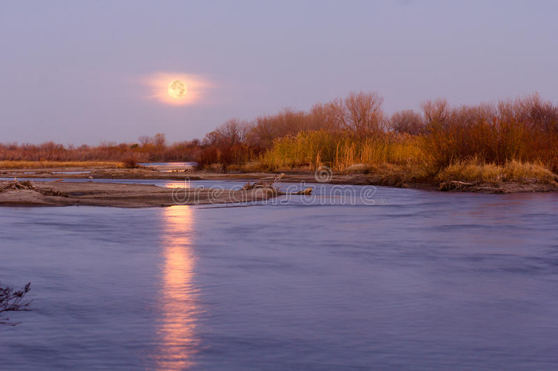 Download Full Moon On The Horizon Reflecting In The Platte River Water Stock Photo - Image: 92773452