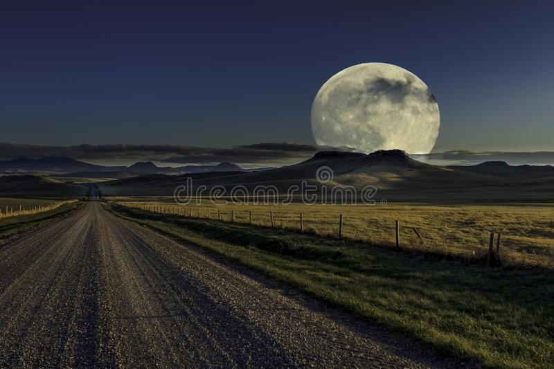 Full moon ion country road royalty free stock photography