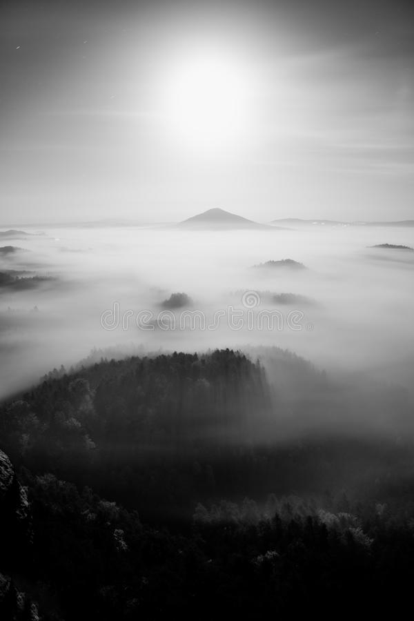 Full moon midnight. Full moon night in a beautiful mountain of Bohemian-Saxony Switzerland. Hilly peaks and trees increased from h stock photo