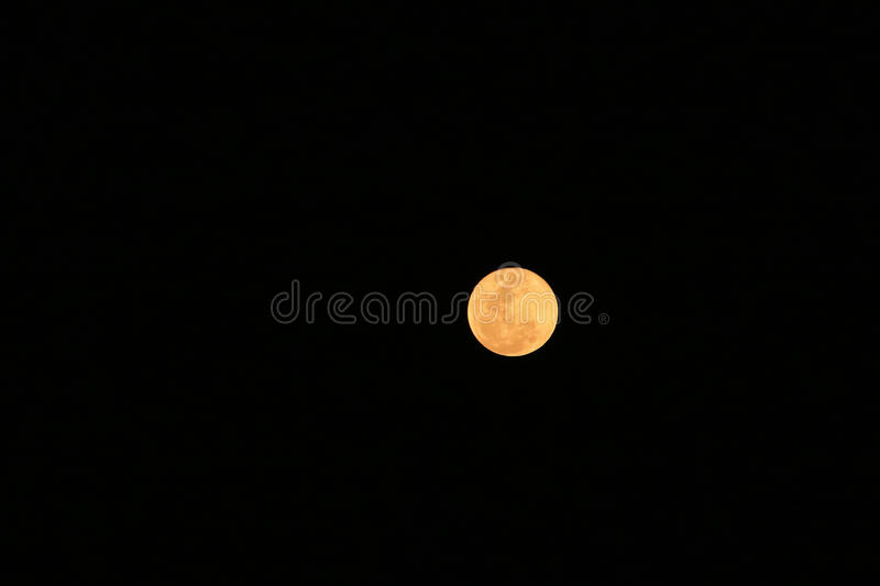 Full moon in the mist on dark night royalty free stock images
