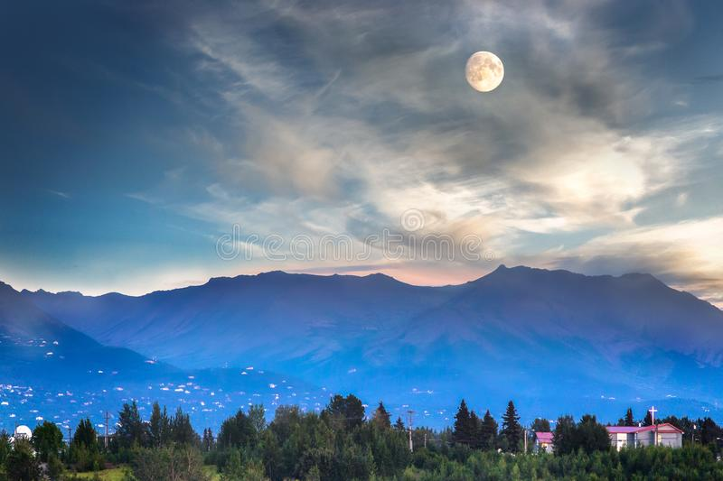 Full moon in Anchorage, Alaska. Full moon and mountains near by the Port Of Anchorage in Alaska, USA royalty free stock photography