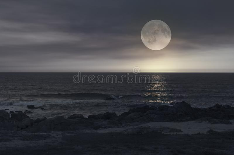 Full moon night in a beach royalty free stock photos