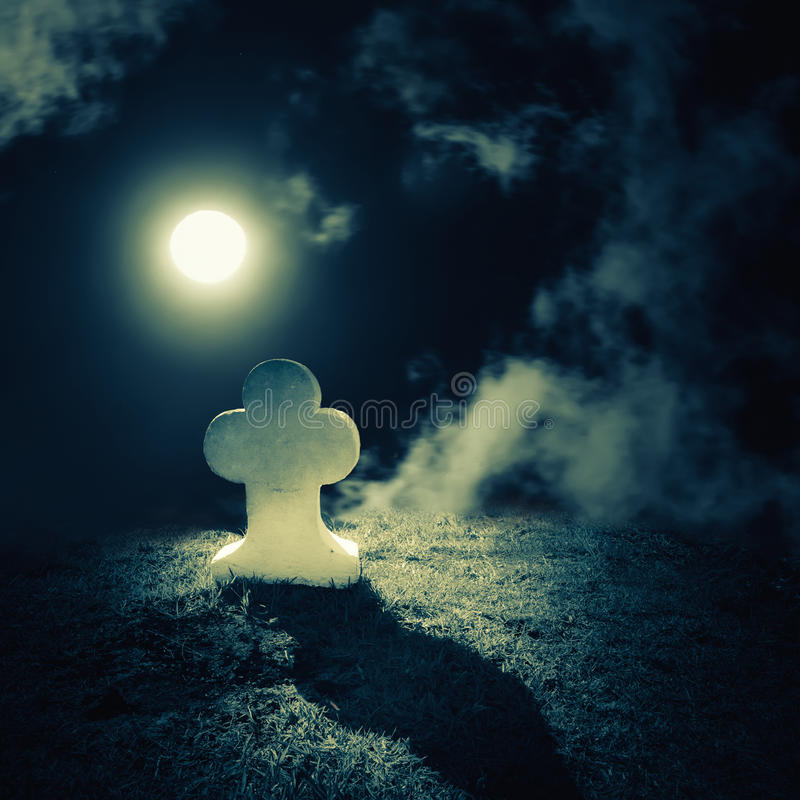 Full moon night landscape with abandoned grave on lonely planet. Dark night spooky landscape with abandoned grave and memory stone on lonely haunted planet under royalty free stock image