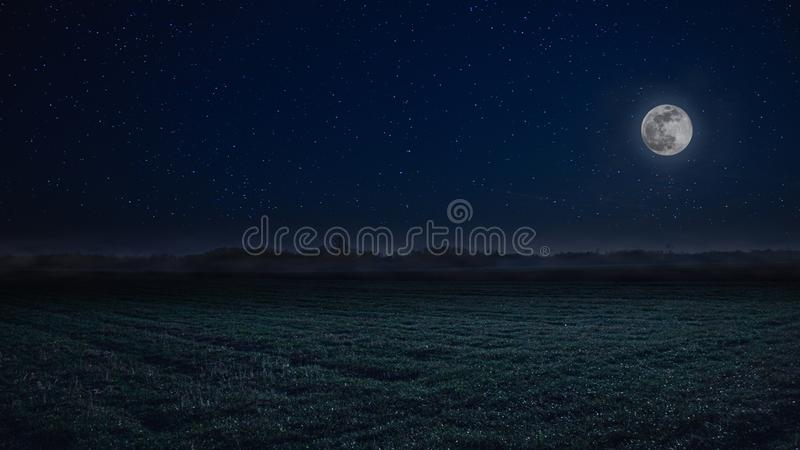 Full moon night landscape with fog in the background royalty free stock photo