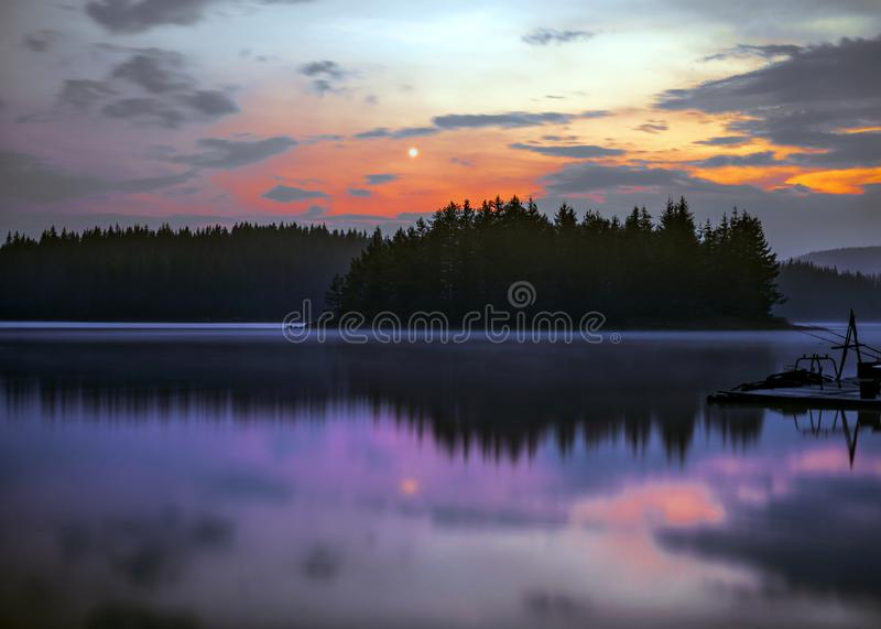 Full moon night mountain lake scene royalty free stock photography