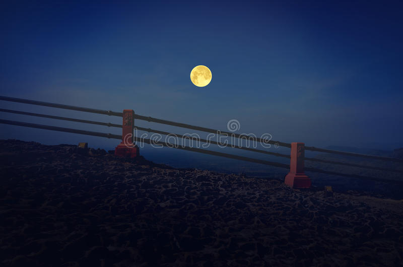 Full moon night over valley and cliff stock images