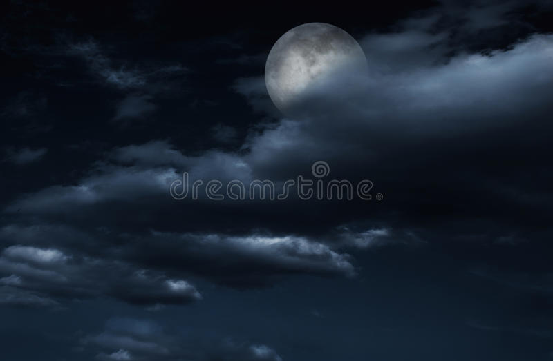 Full moon in night sky with clouds. royalty free stock image