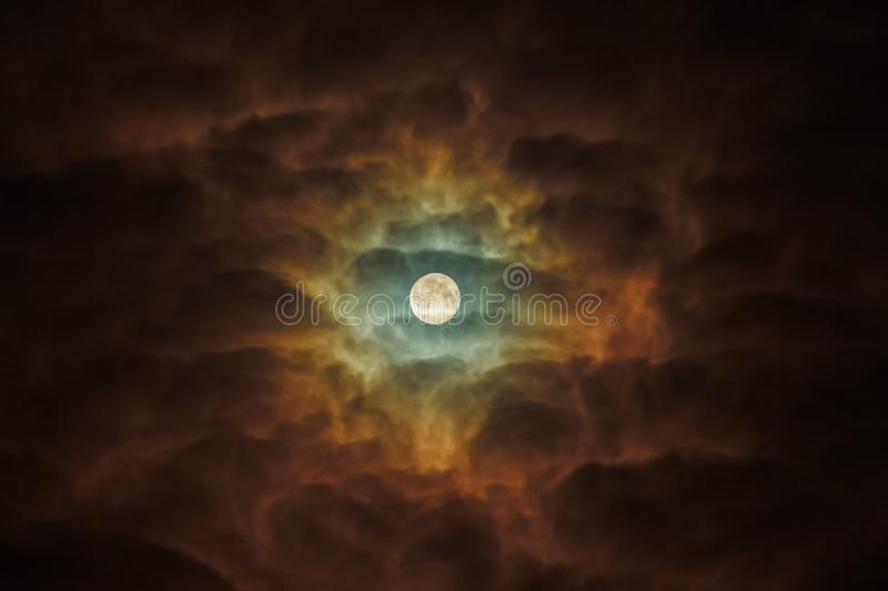A Full Moon Ominously highlights the dark clouds. Night Sky Sunflower. Telescope astrophotography. Detailed Close-Up Full Moon Ominously Highlights The Clouds stock image