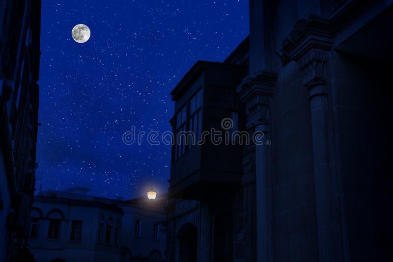 Full moon over the city at night, Baku Azerbaijan. Big full moon shining. Bright over buildings stock photos