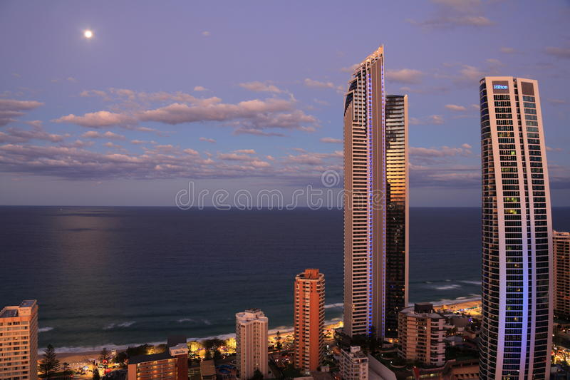 Oceanfront living by full moon scenery stock image