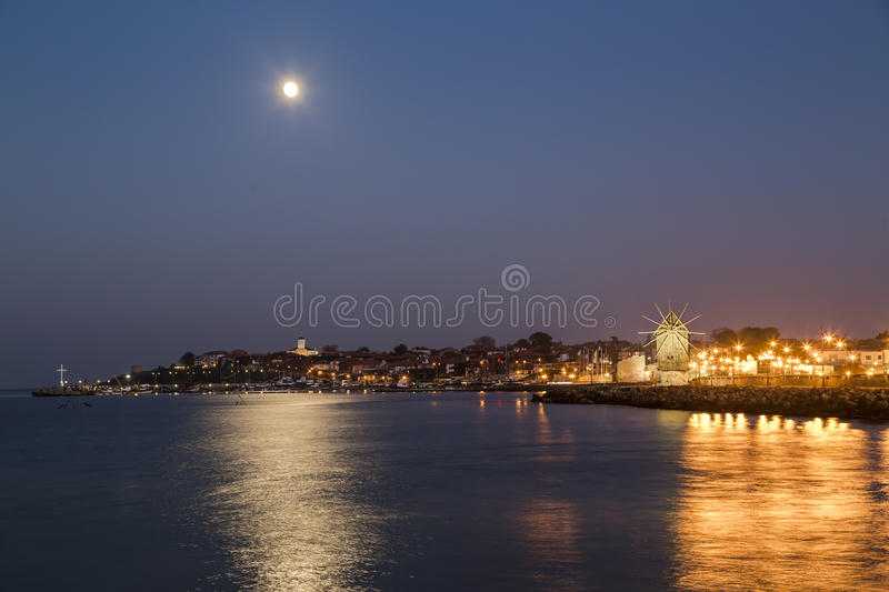 Full moon over the coastal city royalty free stock images