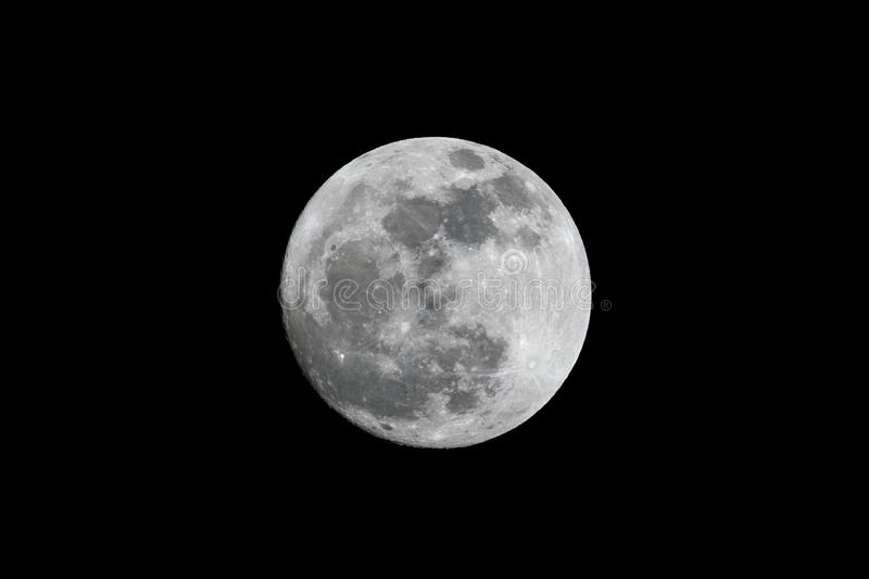 Full moon over dark black sky at night royalty free stock photography