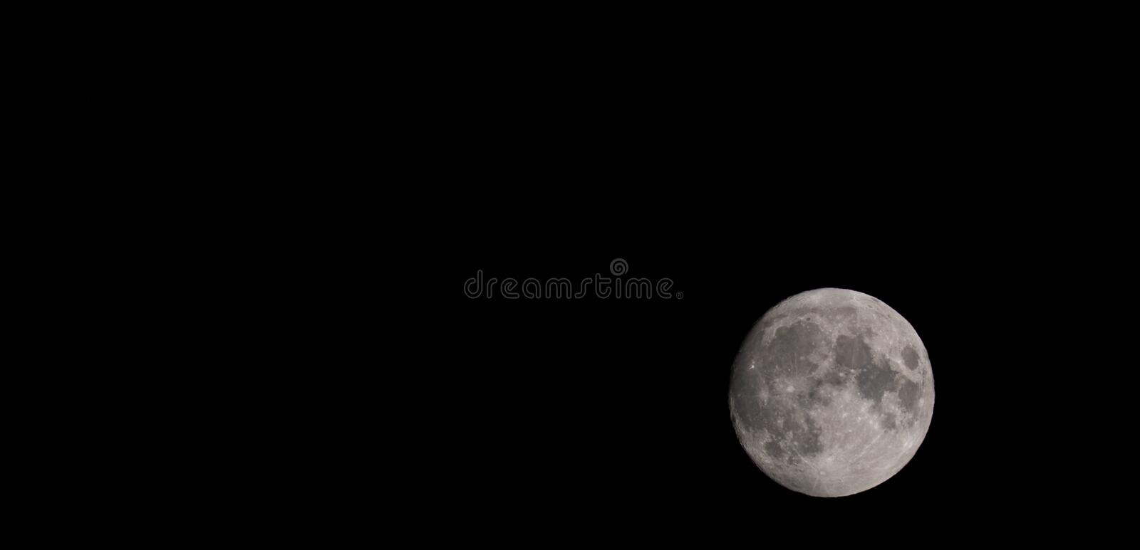 Full moon over dark black sky at night royalty free stock images