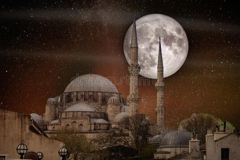 Full moon over the Fatih Mosque. Conqueror`s Mosque, Istanbul, Turkey. Elements of this image furnished by NASA stock photos