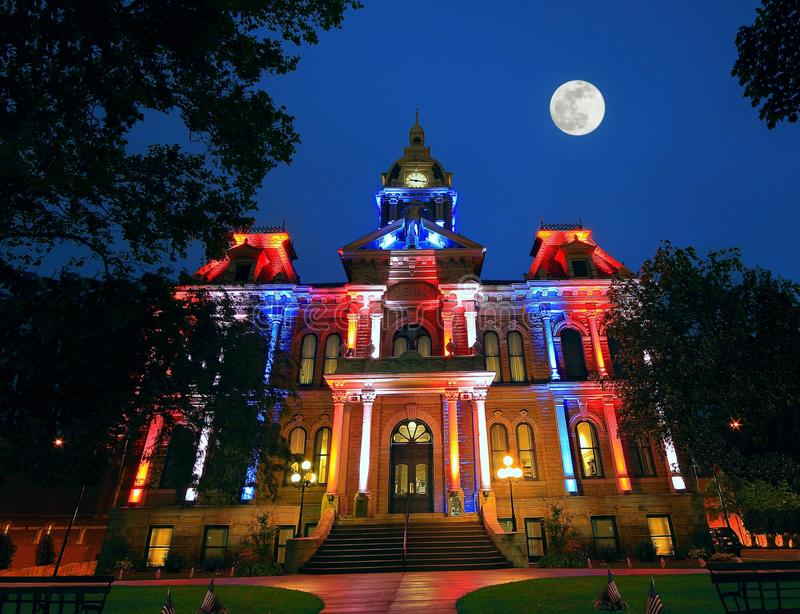 Full Moon over the Guernsey County Courthouse. A full moon over the Guernsey county courthouse in Cambridge Ohio on Independence Day at twilight royalty free stock image
