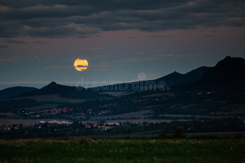 Full moon over the hills stock image