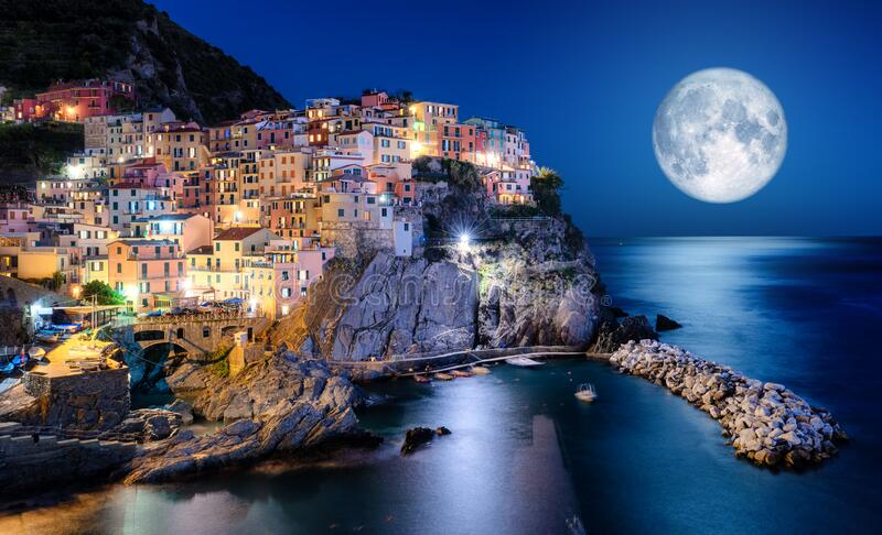 Full moon over Manarola, Cinque Terre, Italy stock photo