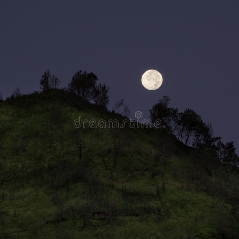 Full moon over mountain. Dramatic shot stock photography