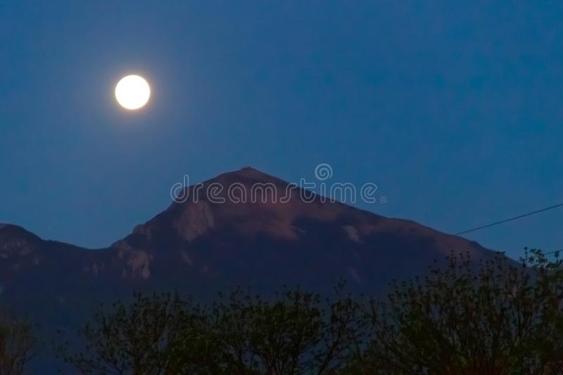 Full moon over the mountain. At night royalty free stock image
